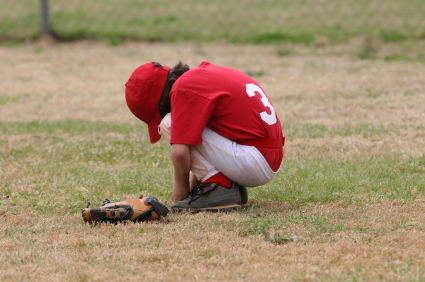 Upset youth baseball player